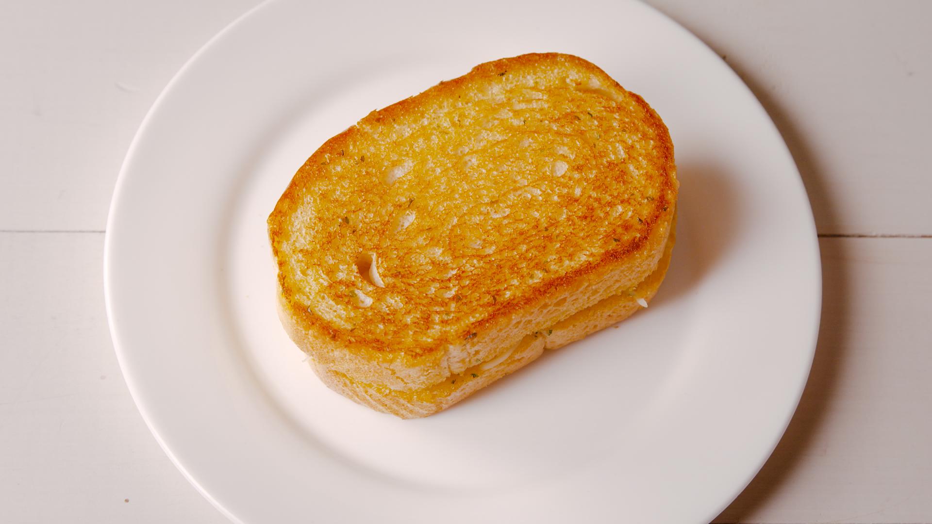 Best Garlic Bread Grilled Cheese Recipe Delish Com