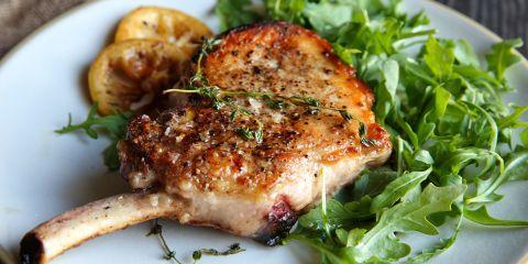 Recipe for seared pork chops with warm lemon vinaigrette.
