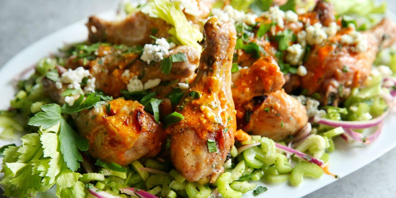 best buffalo chicken drumsticks with celery salad recipe delish com