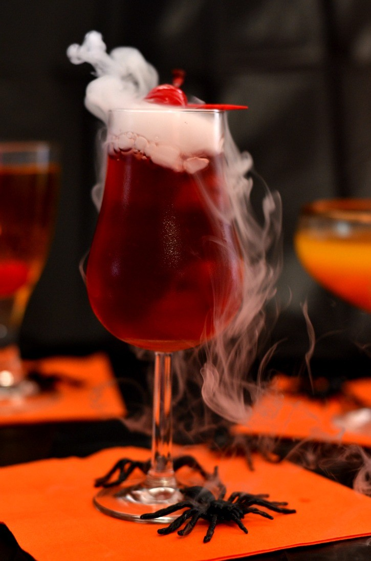 8 easy dry ice drinks cocktails with dry ice for halloweendelishcom - Easy Alcoholic Halloween Punch
