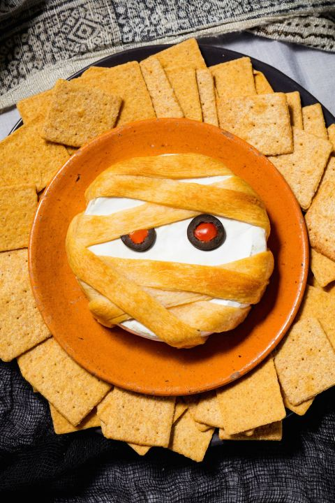 Thanks to puff pastry, your basic baked brie becomes a totally spooky Halloween appetizer. Get the recipe fromDelish. BAKE IT OFF: Calphalon Nonstick Bakeware, $30;