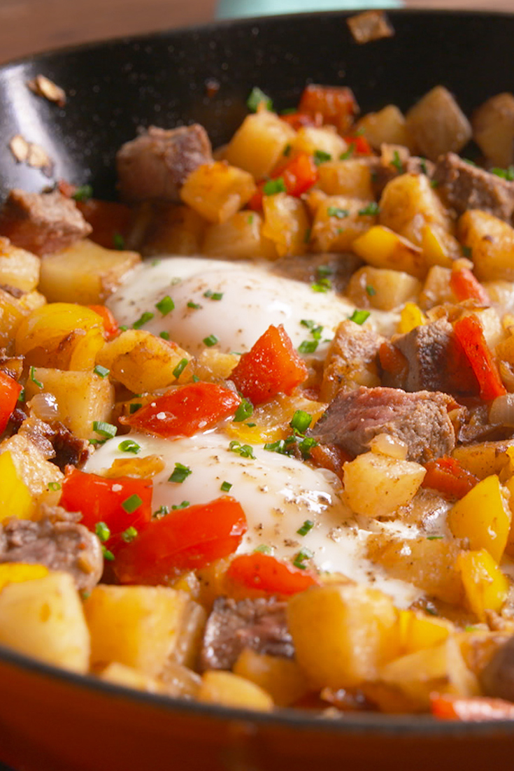 1479415413-delish-steak-and-eggs-hash-pin-07.jpg