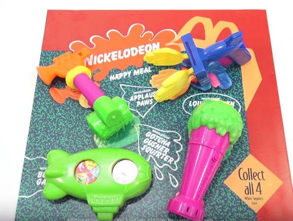 These toys let you bring home what Nick did best on TV: slime (in the form of a microphone), giant orange blimps (that acted as water guns) and slapstick gimmicks (like a hand clap gun).