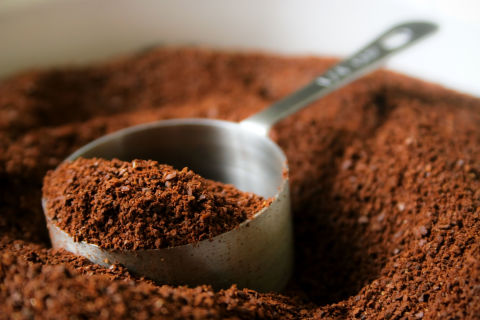 Use the grainy texture of coffee grounds to remove gunk from cooking tools. Just throw in a handful of grounds, scrub away and rinse.