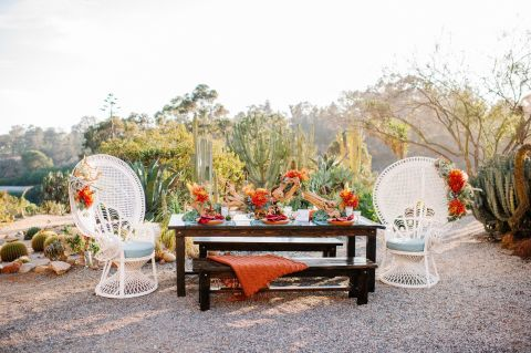 For a desert wedding in San Diego, California, featured on Green Wedding Shoes and captured by Mr. & Mrs. Wedding Duo, the couple went for a rich color palette of rust and turquoise with driftwood and cactus as their (unconventional) floral choice.
