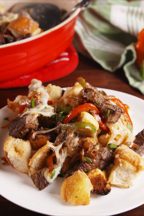 The easiest way to serve philly cheesesteaks to a crowd. Get the recipe fromDelish.