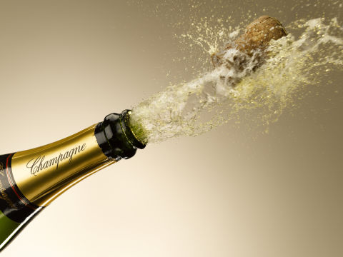 bottle of champagne popping open