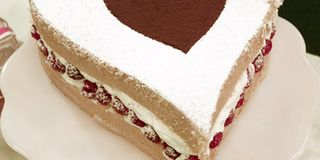Express your love for that special someone with this heart-shaped cake, made with fresh whipped cream and homemade raspberry syrup.Recipe: Valentine Cake