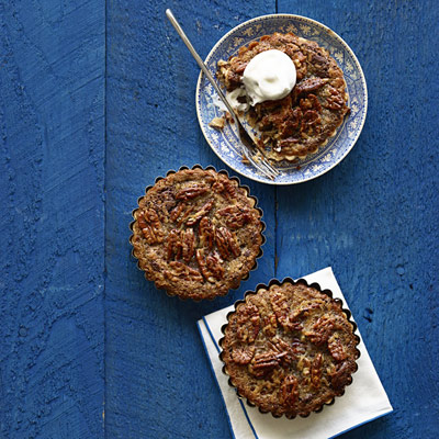 Originally featured in the 1965 edition of Woman's Day magazine, this classic pecan tart is upgraded with luscious chocolate and sweet coconut. Recipe: Mini German Chocolate Brownie Pecan Tarts