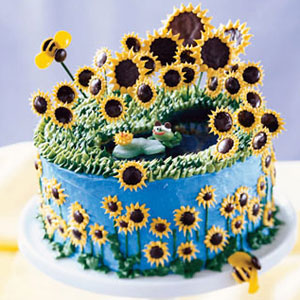 this sweet seasonal cake covered in calming blue and a field of happy sunflowers - Decorated Cakes