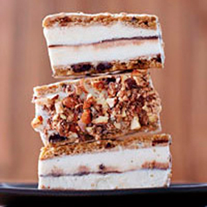 Break-and-bake cookies, which come packaged in eight-inch squares, are the secret to these incredible ice cream sandwich bars. Simply roll out all the dough to create one giant cookie, then bake, slice, and layer it with store-bought ice cream and hot fudge sauce. The best part: dipping the bars into crushed chocolate toffee candy to form a supercrunchy shell.Recipe: Chocolate Chip Cookie Ice Cream Bars