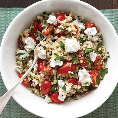 Enjoy this satisfying vegetarian main: a generous bulgur salad with crumbled goat cheese and juicy tomatoes. Recipe: Mediterranean Grain Salad