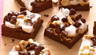 These treats are topped with a chewy layer of marshmallows, nuts, and even more chocolate. The kids will hardly be able to wait until the brownies are cool!Recipe: Rocky Road Brownies