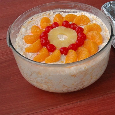 A decadent, almost dessertlike version of a fruit salad, the ambrosia salad usually contains pineapple, mandarin oranges, marshmallows, and coconut with a creamy agent (whipped cream, sour cream, or yogurt) to bind it all together. Search for Ambrosia Salad recipes.