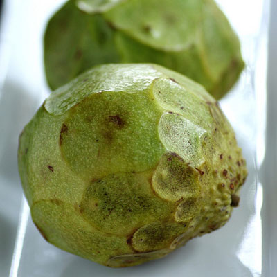 Cherimoyas come from short, shrub-like trees. They have a white flesh, which is extremely soft and sweet. It has almost a custard-like texture, which is why the fruit is also referred to as the custard apple. The flavor or cherimoyas is often compared to sweet fruits like bananas, peaches, and strawberries, but some think they taste like bubblegum!