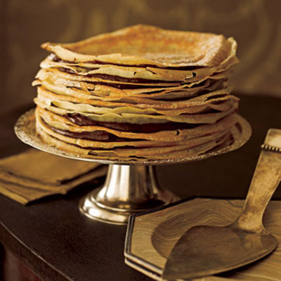 Alternating layers of wafer-thin crepes and rich chocolate pudding make for a deliciously different dessert. To slice the cake, use a long, sharp knife and cut in a smooth sawing motion. Wipe the knife between each cut. Recipe: Crepe Cake