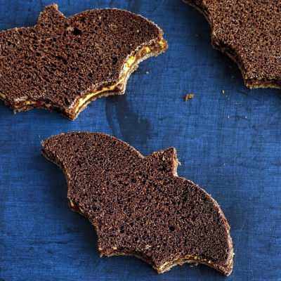 Watch in delight as these bat shaped sandwiches fly into children's mouths. This cheesy sandwich with a kick will definitely spice up your Halloween menu. Recipe: Pimento Cheese and Pumpernickel Sandwiches