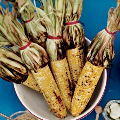 Grilled corn with mango habanero butter recipe bobby flay likes to cook corn on the cob with the husk tied back into a ccuart Gallery