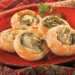 These bite-sized appetizers take all the favorite flavors from restaurant-style spinach-artichoke dip and combine them with flaky puff pastry. They're just perfect for your next gathering.