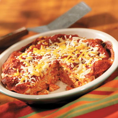 Tender Chicken Enchilada Sauce Cheese And Corn Tortillas Are Layered And Baked Together For