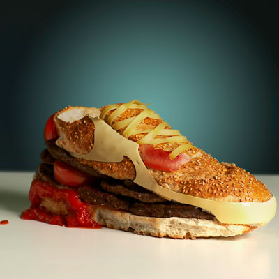 """Creator: Swedish designer Olle HemmendorffDelicious Details: Air Jordan's got nothing on this these babies. As part of an exhibition, Hemmendorf designed the classic Nike Air Max sneakers using a sturdy sesame baguette, beef patties, pickles, tomatoes, and cheese for the iconic swoosh. Why did Hemmendorf choose the hamburger? He wanted to use """"the most powerful, most durable, and most delicious material known to man."""" Bing: The city where the sneaker burger was displayed Find: Shop for the real thing Want a bite? Try these 25 Awesome Grilled Burgers"""