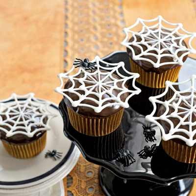 Super-easy white-chocolate toppers appear to float, Houdini-like, over chocolate cupcakes.Recipe: Itsy Bitsy Spiderwebs Cupcakes