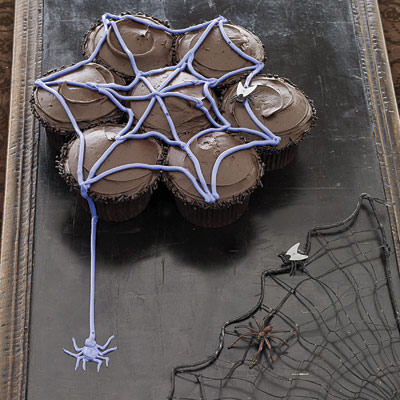 Chocolate cupcakes make the perfect base for a sweet web made from tinted vanilla frosting. Recipe: Cupcake Webs