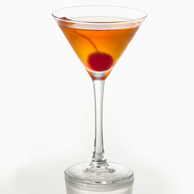 """Also known as the """"Drinking Man's Cocktail,"""" the Manhattan has a much-debated history, but everyone agrees the drink was indeed invented in New York City in the second half of the 1800s. Whiskey, sweet vermouth, and maraschino cherries are the unwavering ingredient list.Recipe: Manhattan"""