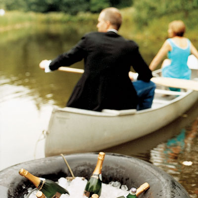 A Black Tie Dinner Served At Table Reachable Only By Canoe Trip Across