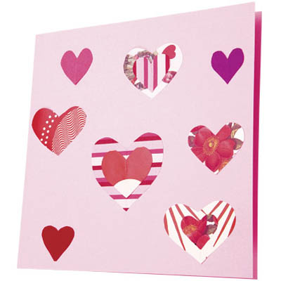 Homemade diy valentines day cards to make this pretty patterned valentine cut small heart shapes of varying sizes out solutioingenieria Images