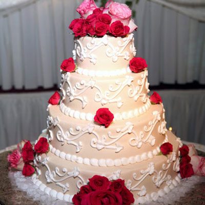 Consider An Ivory Quinceanera Cake With Luscious Roses If You Re Wearing White And Your
