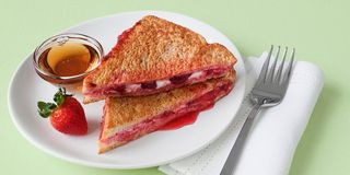 In a shallow bowl, mix 1/2 cup fat-free liquid egg substitute (such as Egg Beaters Original) with 1/4 tsp cinnamon and 1/2 tsp vanilla extract.Lay 2 slices of light white bread on a plate. Spread 1/2 a wedge of Laughing Cow Light Original Swiss cheese on each slice and 2 Tbsp sugar-free strawberry preserves on one slice. Press the slices together so the cheese and jam are touching.Bring a skillet to medium-high heat and melt 2 tsp light whipped butter or vegetable oil spread (like Brummel & Brown). Meanwhile, dunk your sandwich in the egg mixture to coat both sides. Place sandwich in skillet and cook for 2 to 4 minutes on each side, until golden brown. Serve with 1/4 cup sugar-free pancake syrup for dipping.Makes 1 serving.Each serving: 263 calories, 6g fat, 42g carb, 5g fiber, 19g protein