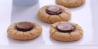 These cookies will have a moist, brownielike texture the day you make them and get crispier the following day. You can also make them with other favorite chocolate candies. Store the cookies in an airtight container for up to two weeks. Adding marshmallows to the container will prevent the cookies from drying out.Recipe: Peanut Butter Surprise Cookies