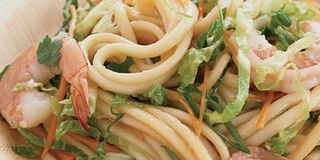 Instead of spending time shredding cabbage and carrots, Grace Parisi uses prepackaged coleslaw mix. She tosses it with noodles and shrimp, then adds a spicy, gingery dressing prepared with other easy-to-find supermarket ingredients, like bottled teriyaki sauce and chile-garlic sauce.Recipe: Shrimp and Noodle Salad with Ginger Dressing