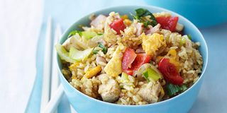 Curry powder adds extra kick to the classic stir-fry combo of rice, chicken, and vegetables. Recipe: Singapore-Style Chicken Fried Rice